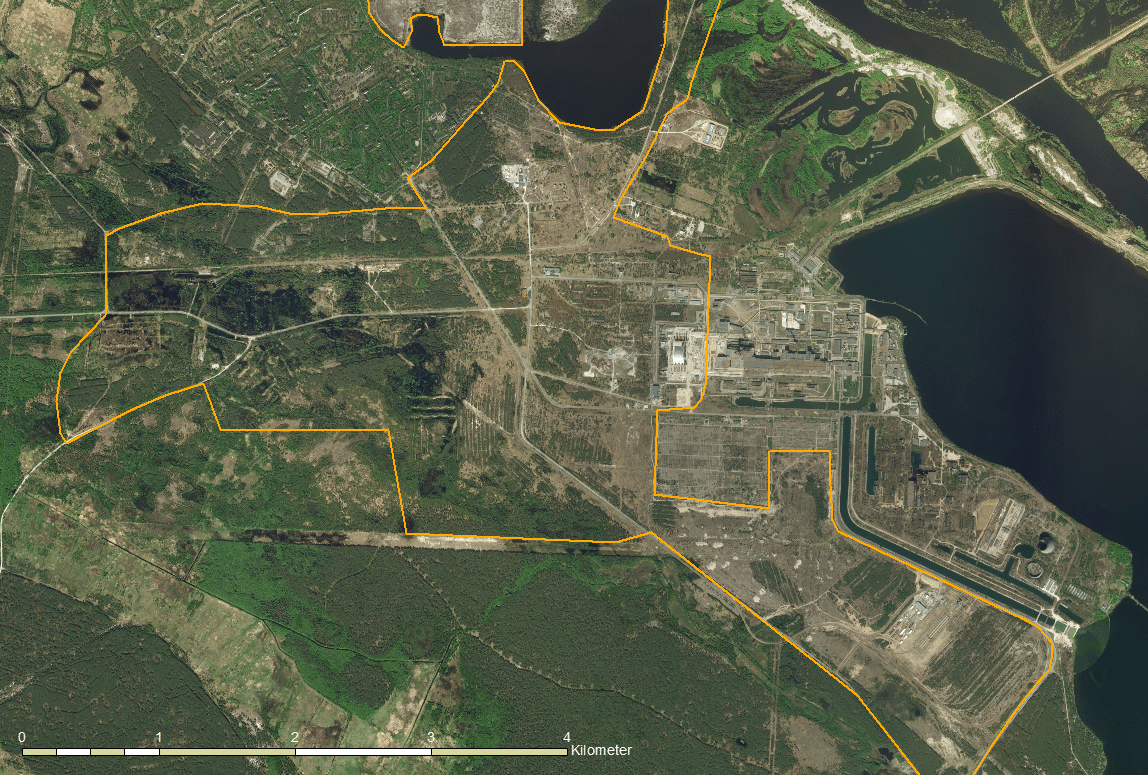 Figure 2: The Chernobyl nuclear power plant area from air. Orange marked the potential study area (Source: Munich University of Applied Sciences / Quantum-Systems; Image created using ESRI ArcGIS for Desktop and ESRI ArcGIS Server World Imagery)